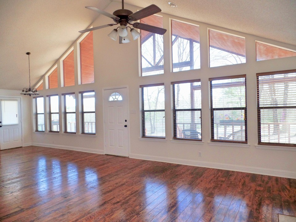 wall of windows with engineered wood floors