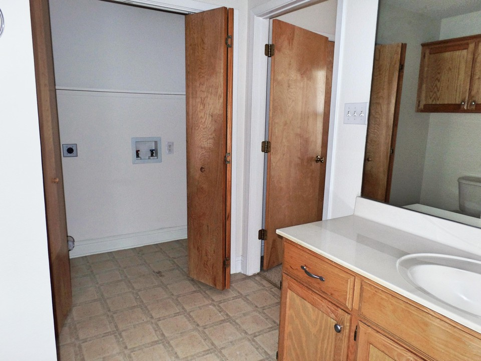 master bath with utility closet