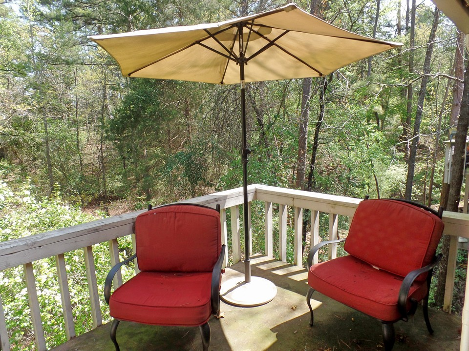 private balcony overlooking natural beauty of holly lake ranch