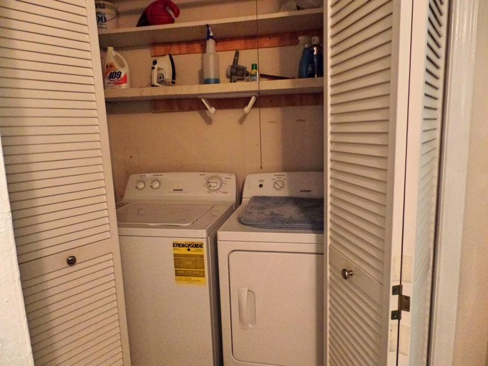 utility closet with shelves on first floor