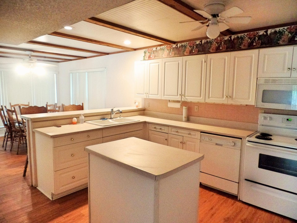 kitchen with breakfast bar open to dining
