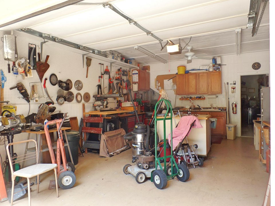 1 car garage or workshop attached to guest house