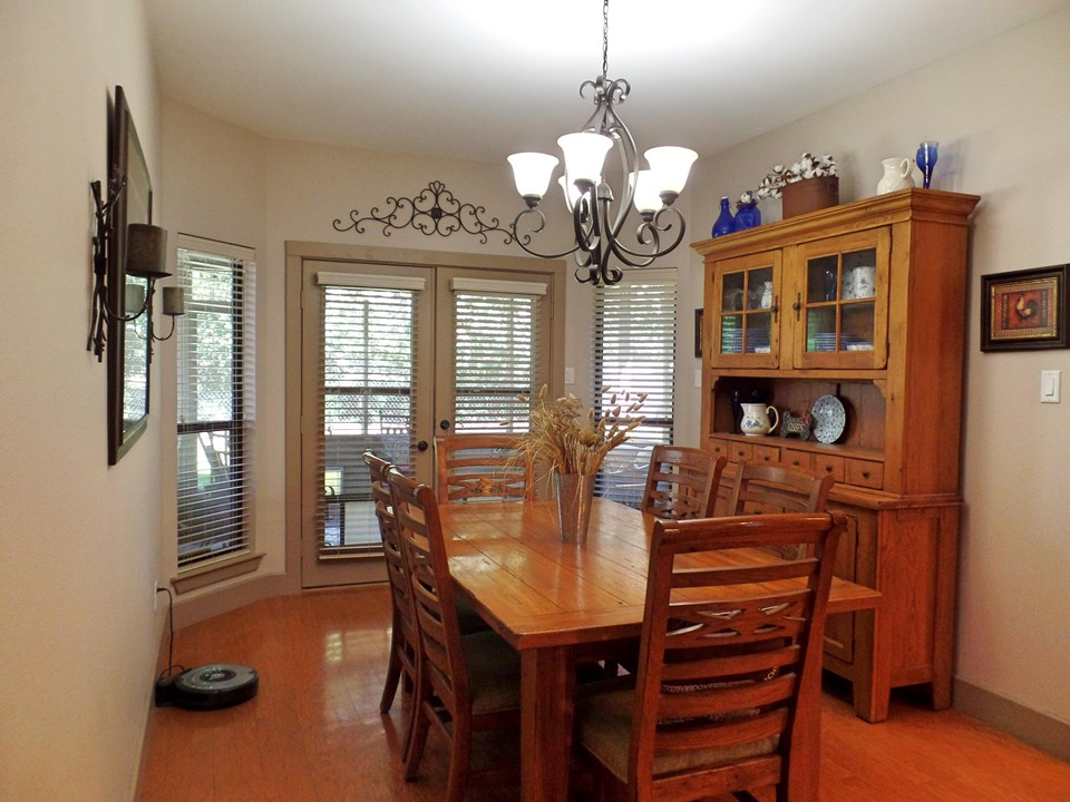 dining with french doors to screened porch
