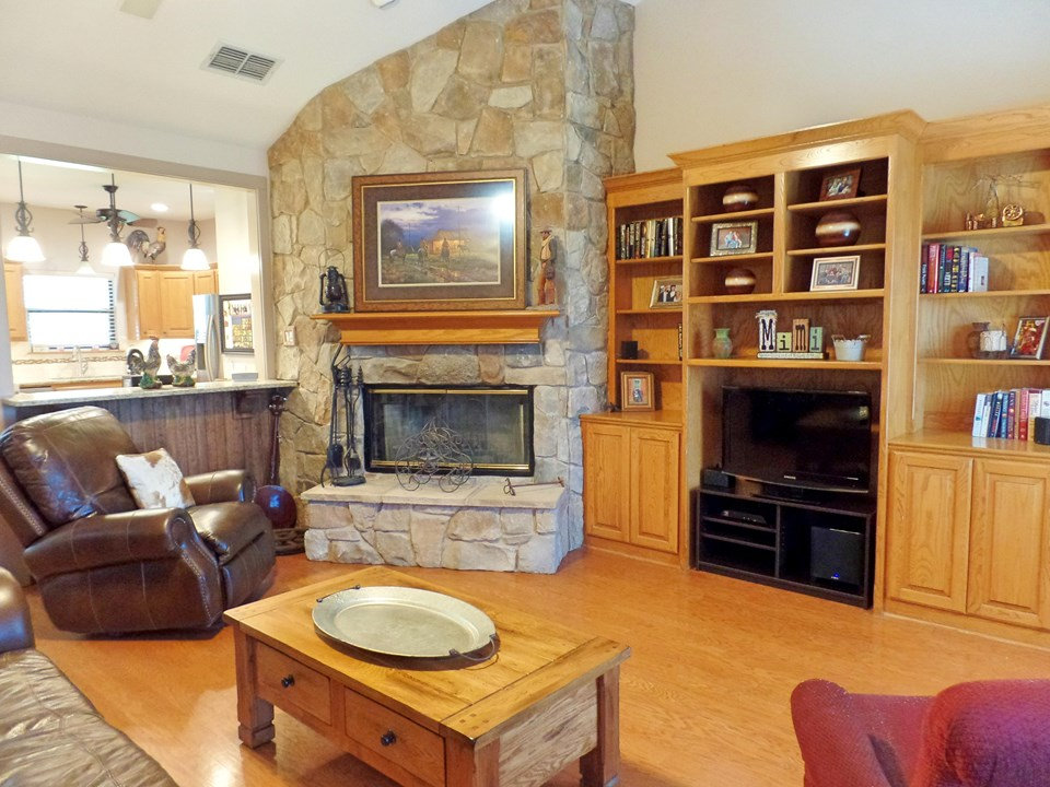 hardwood floors, corner stone fireplace and built-ins