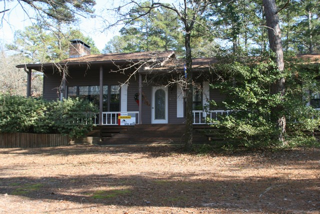 centrally located on 6 lots in the rolling piney woods.