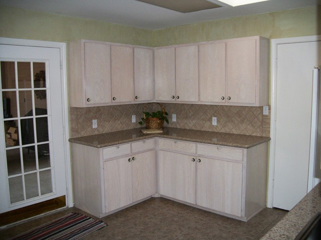 lots of cabinets with a walk-in pantry  to the right.