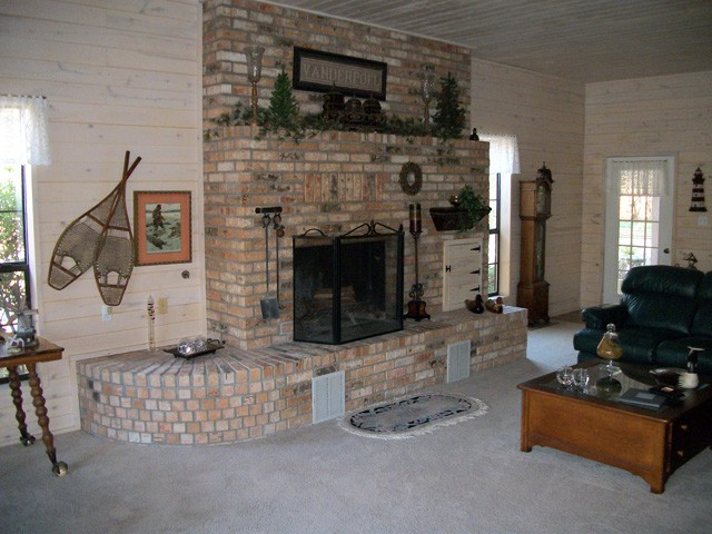 brick fireplace which is a highlight of the large living room.